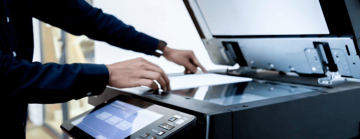 close up of a businessman putting paper on a multifunction printer scanner tray