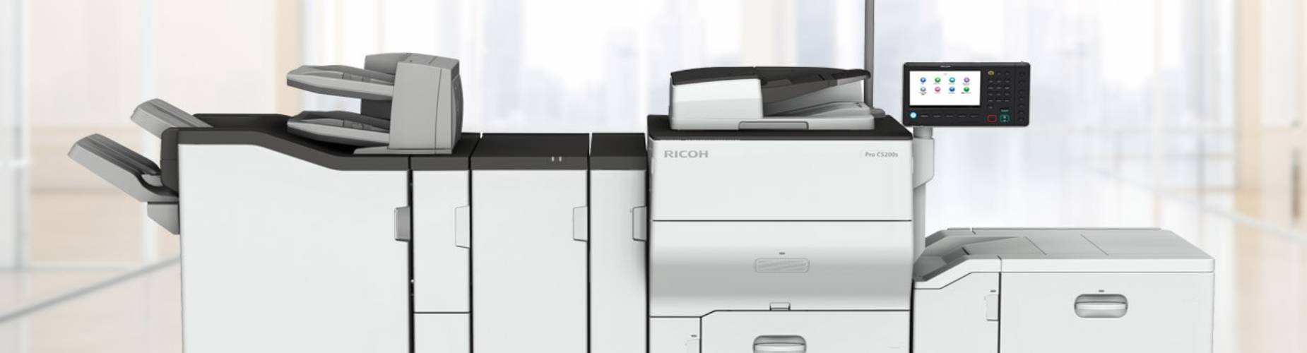 Ricoh Large Format Printer in a large open workspace